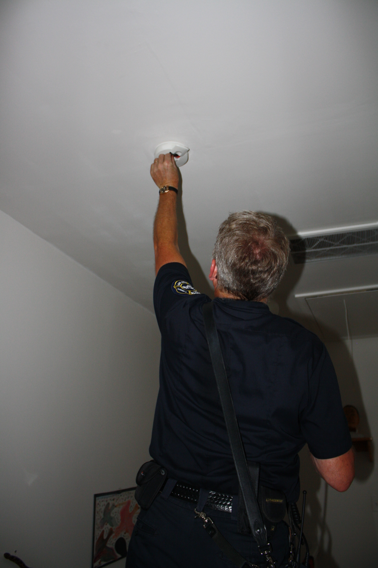 Firefighter Checking Smoke Alarm Batteries