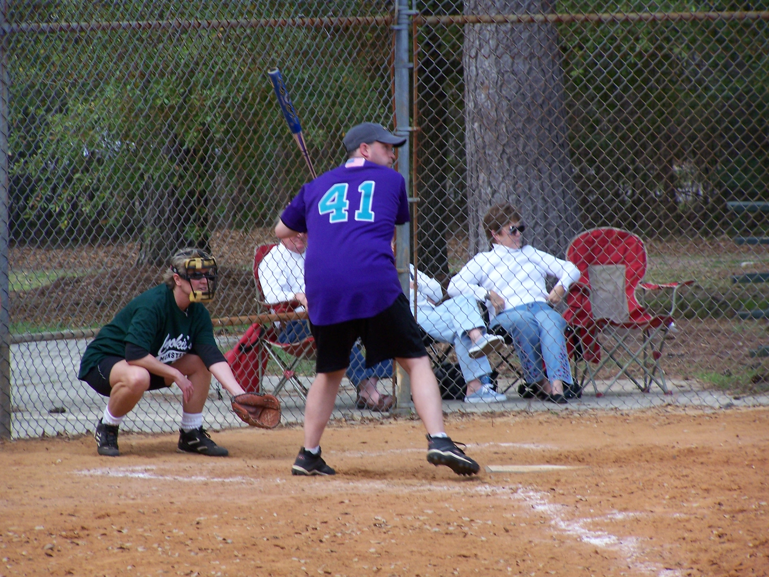 Man at base about to swing playing softball