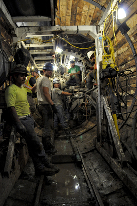 Workers Operate the Tunnel Boring Machine
